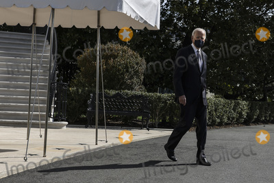 Marine One Photo - United States President Joe Biden walks on the South Lawn of the White House before boarding Marine One on March 19 2021 in Washington DCCredit Oliver Contreras  Pool via CNPAdMedia