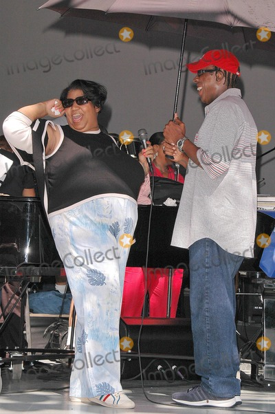 Arsenio Hall Photo - Aretha Franklin and Arsenio Hall at the sound check rehearsal for Arethas concert at the Greek Theatre Los Angeles CA 09-17-04