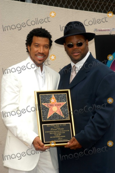 Jimmy Jam Photo - Lionel Richie and Jimmy Jam at Richies induction ceremony into the Hollywood Walk of Fame Hollywood CA 06-20-03