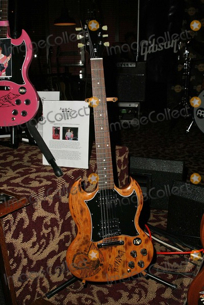 Aerosmith Photo - Aerosmiths custom decorated guitarthat will be auctioned off to raise funds for the Expedition Inspiration Fund for Breast Cancer Research Hard Rock Cafe Los Angeles CA 05-03-05