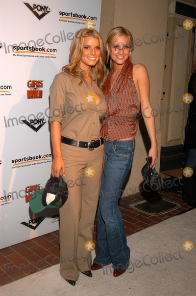Ashely Simpson Photo - Jessica Simpson and sister Ashely Simpson at the pre-Super Bowl party thrown by Pony Girls Gone Wild and Sportsbookcom Market Street San Diego CA 01-24-03