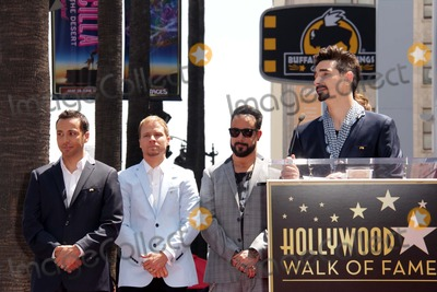 AJ MCLEAN Photo - Howie Dorough Brian Littrell AJ McLean Kevin Richardsonat the Backstreet Boys Star on the Walk of Fame Hollywood CA 04-22-13