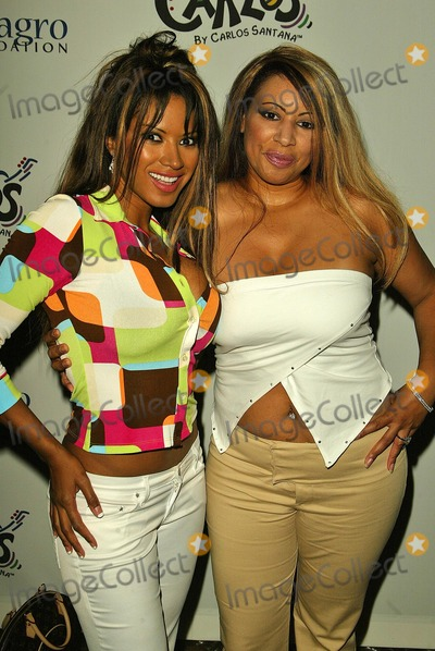 Carlos Santana Photo - Traci Bingham and Jenna Bingham at the Deborah and Carlos Santana Milagro Foundation Benefit on the rooftop of the Hyatt On Sunset West Hollywood CA 08-31-04
