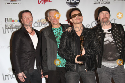 Adam Clayton Photo - Larry Mullen Jr Adam Clayton Bono and The Edge of U2at the 2011 Billboard Music Awards Press Room MGM Grand Garden Arena Las Vegas NV 05-22-11