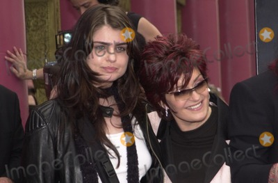 Aimee Osbourne Photo - Aimee Osbourne and mom Sharon Osbourne at Ozzys star on the Walk of Fame ceremony in front of Ripleys Believe It Or Not museum on Hollywood Blvd 04-12-02