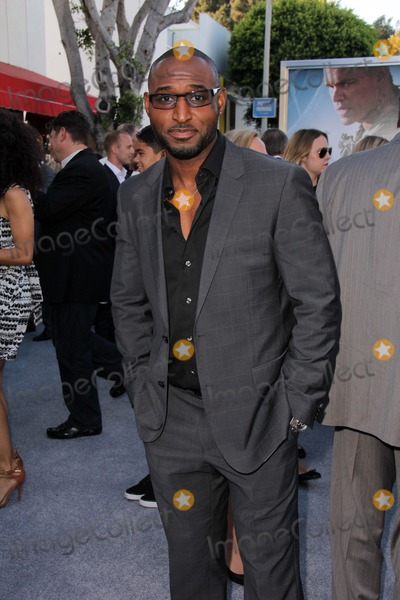 Adrian Holmes Photo - Adrian Holmesat the Elysium Los Angeles Premiere Village Theater Westwood CA 08-07-13