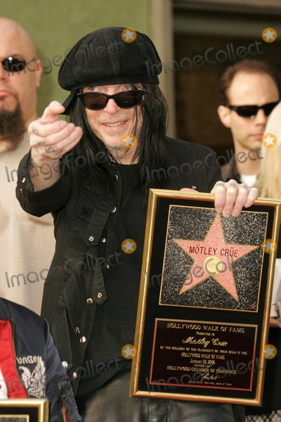 Motley Crue Photo - Mick Mars of Motley Crueat the ceremony honoring them with the 2301st star on the Hollywood Walk of Fame Hollywood Boulevard CA 01-25-06
