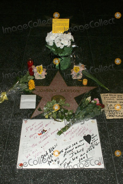 Johnny Carson Photo - Flowers and fan tributes at Johnny Carsons Star on the Hollywood Walk of Fame Hollywood CA 01-23-05