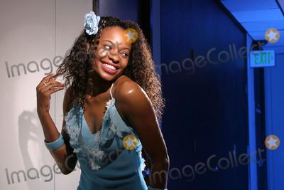 Kena Zakia Photo - Kena Zakia at a photo shoot to promote the luanch of her web site KenaZakiacom Private Location Los Angeles CA 10-10-04