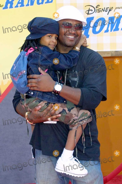 Aries Spears Photo - Aries Spears and daughter at the World Premiere of Disneys Home On The Range in the El Capitan Theatre Hollywood CA 03-21-04