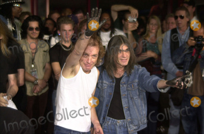 Angus Young Photo -  Angus Young Malcolm Young at the ceremony where they were inducted into Sunset Blvds Rockwalk 09-15-00