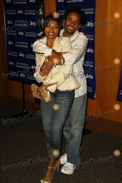 Taraji P Henson Photo - Taraji P Henson and Hill Harper at a special screening of Fahrenheit 911 as part of the LA Film Festival Directors Guild of America Los Angeles CA 06-22-04