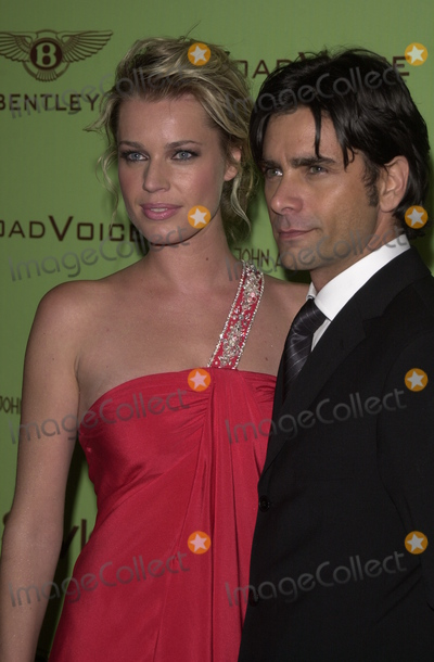 Elton John Photo - Rebecca Romijn-Stamos and John Stamos at the Sir Elton Johns 12th Annual Academy Awards Viewing Party in West Hollywood CA 02-29-04