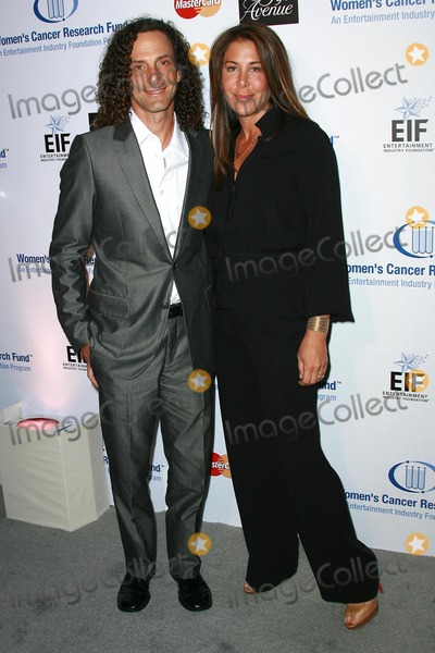 Kenny G Photo - Kenny G and guest at Saks Fifth Avenues Unforgettable Evening To Benefit EIFs Womens Cancer Research Fund Beverly Wilshire Hotel Beverly Hills CA 02-20-08