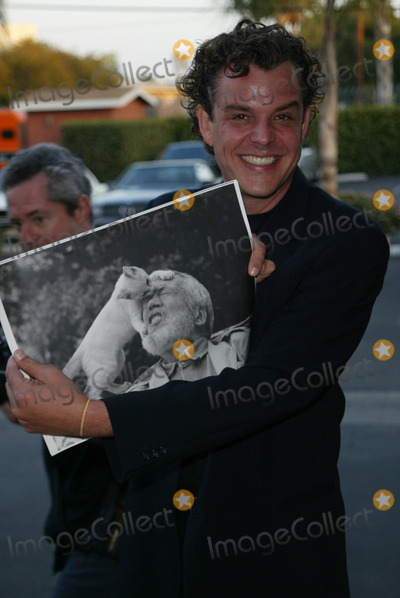 John Huston Photo - Danny Huston with a picture of Father John Huston at the premiere of Ivans Etc at Raleigh Studios Hollywood 06-04-02