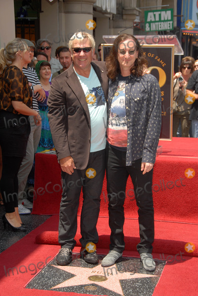 Alex Lifeson Photo - Alex Lifeson and Geddy Lee at the induction ceremony for RUSH into the Hollywood Walk of Fame Hollywood CA 06-25-10