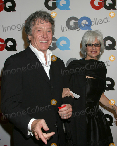 Michael Cole Photo - Michael Cole and wifeGQ Magazine 2005 Men of the Year PartyMr Chow Beverly HillsBeverly Hills CADecember 1 2005