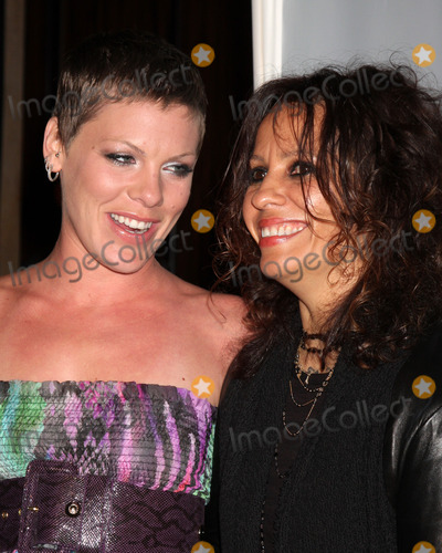 Alecia Moore Photo - Pink (Alecia Moore) Linda Perryarrives at An Evening with Women - LA Gay  Lesbian Centers GalaBeverly Hilton HotelBeverly Hills CAMay 1 2010