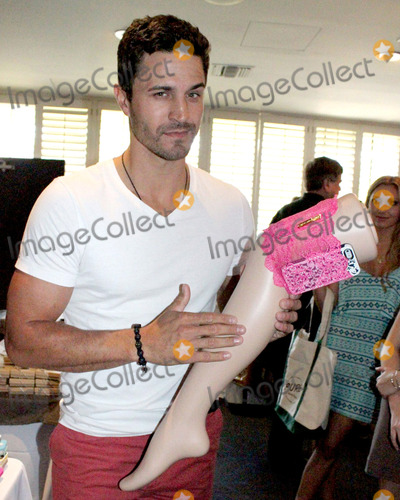 Anderson Davis Photo - LOS ANGELES - AUG 9  Anderson Davis at the Girly Go Garter  at 2013 Kiis FM Teen Choice Gift Suite at W Hotel Hollywood on August 9 2013 in Los Angeles CAThe GirlyGoGarter adheres to the thigh with secure GentleFlex Grippers and closes with baby-soft size adjusting Velcro  GirlyGoGarter is created by first time fashion designer TV stylist Andy PaigeProduct is available at girlygogartercom for 3500 in Black Blue Hot pink Beige Nude and Red as of 112013Contact Dcracknellcopyrightleonardgeorgetv for additional information