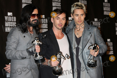 30 Seconds to Mars Photo - LOS ANGELES - SEP 12  Tomo Milicevich Shannon Leto and Jared Leto of 30 Seconds to Mars in the Press Room  at the 2010 MTV Video Music Awards  at Nokia - LA Live on September 12 2010 in Los Angeles CA
