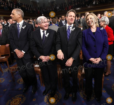 Robert gates Photo - Members of President Barack Obamas Cabinet from left Attorney General Eric Holder Defense Secretary Robert Gates Treasury Secretary Timothy Geithner and Secretary of State Hillary Rodham Clinton are seen on Capitol Hill in Washington Tuesday January 25 2011 prior to the start of the presidents State of the Union address  Photo by Pablo Martinez Monsivais PoolCNP-PHOTOlinknet