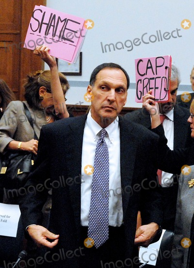 Richard S Fuld Jr Photo - RESTRICTED NO NEW YORK OR NEW JERSEY NEWSPAPERS WITHIN A 75 MILE RADIUS OF NYCWashington DC - October 6 2008 -- Richard S Fuld Jr Chairman and Chief Executive Officer Lehman Brothers Holdings is greeted by protestors as he enters the committee room to testify before the United States House Committee on Oversight and Government Reform hearing on The Causes and Effects of the Lehman Brothers Bankruptcy in the Rayburn House Office BuildingPhoto by Ron Sachs-CNP-PHOTOlinknet