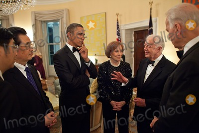 Jimmy Carter Photo - UNited States President Barack Obama along with President Hu Jintao of China former First Lady Rosalynn Carter and Vice President Joseph Biden listen to former President Jimmy Carter during a reception in the Yellow Oval Room in the Residence of the White House Wednesday January 19 2011 Photo by Pete Souza White House CNP-PHOTOlinknet