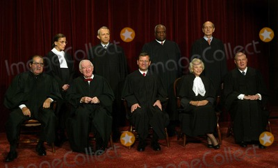 Antonin Scalia Photo - Washington DC - March 3 2006 -- 2006 Class Portrait of the Justices of the United States Supreme Court taken March 3 2006 at the United States Supreme Court Building in Washington DC  Seated in the front row from left to right are Associate Justice Anthony M Kennedy Associate Justice John Paul Stevens Chief Justice of the United States John G Roberts Jr Associate Justice Antonin Scalia and Associate Justice David Souter Standing from left to right in the top row are Associate Justice Stephen Breyer Associate Justice Clarence Thomas Associate Justice Ruth Bader Ginsburg and Associate Justice Samuel Alito Jr  Stevens the longest serving Justice was nominated by United States President Gerald R Ford He took his seat in December 1975   Alito the newest Justice was sworn-in on January 31 2006 He replaced Sandra Day OConnor  the first woman to serve as Associate Justice of the United States  Supreme Court  Photo by Pool-CNP-PHOTOlinknet
