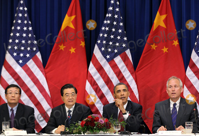 Alex Wong Photo - WASHINGTON DC - JANUARY 19 (AFP OUT) US President Barack Obama (2nd R) and Chinese President Hu Jintao (2nd L) meet with US and Chinese business leaders and CEOs at the Eisenhower Executive Office Building January 19 2011 in Washington DC Obama and Hu met in the Oval Office earlier in the day and will attend a State dinner this evening  Photo by  Alex WongPoolCNP-PHOTOlinknet