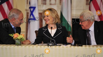 ABBA Photo - United States Secretary of State Hillary Rodham Clinton center smiles as Prime Minister Benjamin Netanyahu of Israel left and Mahmoud Abbas of the Palestinian Authority share some thoughts following their remarks at the start of the Relaunch of Direct Negotiations Between the Israelis and Palestinians in the Benjamin Franklin Room of the US Department of State on Thursday September 2 2010  Credit Ron Sachs  CNP(RESTRICTION NO New York or New Jersey Newspapers or newspapers within a 75 mile radius of New York City)