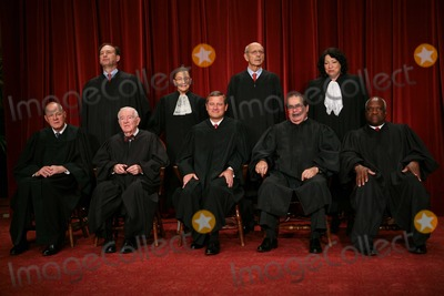 Antonin Scalia Photo - Washington DC - September 29 2009 -- The Justices of the United States Supreme Court posed for their official family  group photo and then allowed members of the media to take photos afterwards at the US Supreme Court in Washington DC on Tuesday September 29 2009 Front row left to right Associate Justice Anthony M Kennedy Associate Justice John Paul Stevens Chief Justice of the United States John G Roberts Jr Associate Justice Antonin Scalia and Associate Justice Clarence Thomas  Back row left to right Associate Justice Samuel A Alito Jr Associate Justice Ruth Bader Ginsburg Associate Justice Stephen G Breyer and Associate Justice Sonia SotomayorPhoto by Gary FabianoPOOL-CNP-PHOTOlinknet