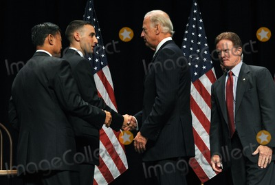 Eric Shinseki Photo - Fairfax VA - August 3 2009 -- United States President Joe Biden right center shakes hands with Marine Corps Staff Sergeant James Miller left center during an event to mark the implementation of the Post-911 GI Bill at George Mason University in Fairfax Virginia on Monday August 3 2009 With them are US Secretary of Veterans Affairs General Eric Shinseki left and US Senator Jim Webb (Democrat of Virginia) right  Photo by Roger WallenbergPOOL-CNP-PHOTOlinknet