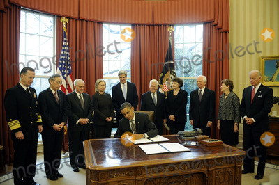 Robert gates Photo - United States President Barack Obama signs the New START Treaty during a ceremony in the Oval Office of the White House with from left Joint Chiefs of Staff Chairman Admiral Mike Mullen US Secretary of Energy Steven Chu US Secretary of Defense Robert Gates US Secretary of State Hillary Rodham Clinton US Senator John Kerry (Democrat of Massachusetts) US Senator Richard Lugar (Republican of Indiana) US Senator Dianne Feinstein (Democrat of California) US Senator Thad Cochran (Republican of Mississippi) US Senator Jeanne Shaheen (Democrat of New Hampshire) and US Vice President Joe Biden Photo by Leslie E Kossoff  PoolCNP-PHOTOlinknet