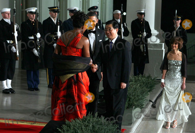 Alex Wong Photo - WASHINGTON DC - JANUARY 19  US President Barack Obama (C) and first lady Michelle Obama (L) welcome Chinese President Hu Jintao for a State dinner at the White House January 19 2011 in Washington DC Obama and Hu met in the Oval Office earlier in the day  Photo by  Alex WongPoolCNP-PHOTOlinknet