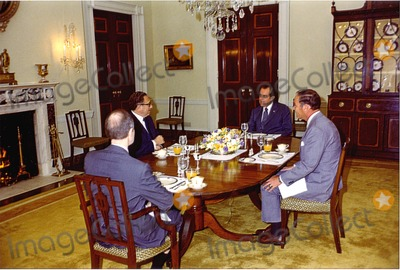 President Nixon Photo - Washington DC - May 31 1974 -- United States President Richard M Nixon sits down to a meal with his national security staff in the White House in Washington DC on May 31 1974 Pictured from left to right Major General Brent Scowcroft United States Air Force Deputy Assistant to the President for National Security Affairs United States Secretary of State Henry A Kissinger who also holds the title of Assistant to the President  for National Security Affairs President Nixon and General Alexander M Haig Jr United States Army Assistant to the President (Chief of Staff)Credit White House via CNPPHOTOlinknet
