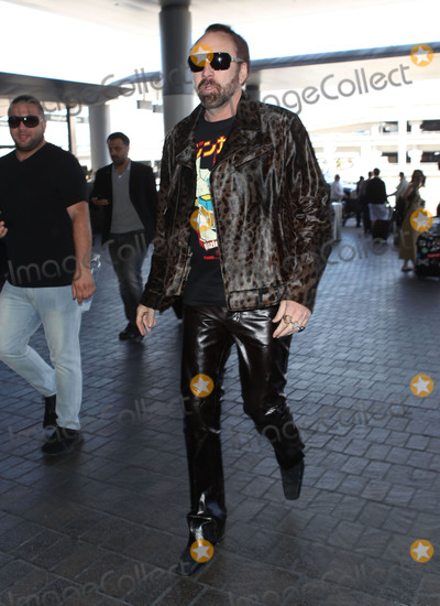 Nicolas Cage Photo - Photo by SMXRFstarmaxinccomSTAR MAXCopyright 2018ALL RIGHTS RESERVEDTelephoneFax (212) 995-119691818Nicolas Cage is seen at Los Angeles International Airport (LAX) in Los Angeles CA
