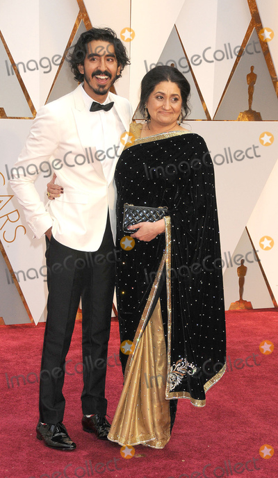 Dev Patel Photo - Photo by GalaxystarmaxinccomSTAR MAXCopyright 2017ALL RIGHTS RESERVEDTelephoneFax (212) 995-119622617Dev Patel and his mother at the 89th Annual Academy Awards (Oscars)(Hollywood CA USA)