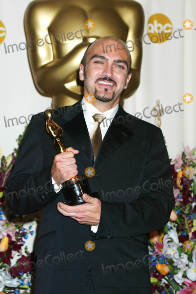 Angus Strathie Photo - Photo by Russ EinhornSTAR MAX Inc - copyright 200232402Angus Strathie in the press room at The Oscars ( The Kodak Theater Hollywood California )