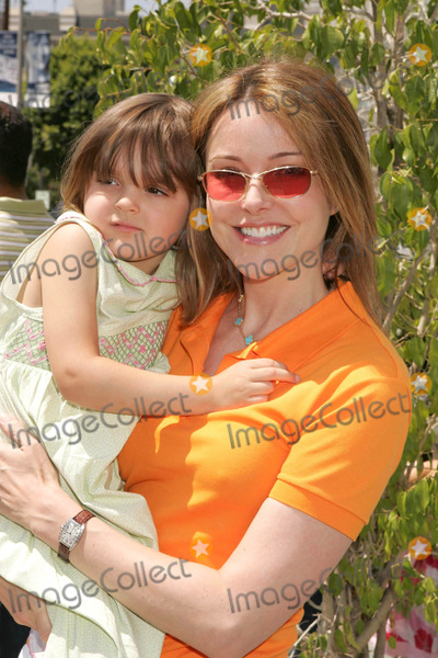 Krista Miller Photo - Photo by REWestcomstarmaxinccom200462604Krista Miller and daughter at the opening of Nanas Garden Spa(Beverly Hills CA)