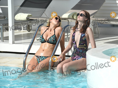 Ashley James Photo - Photo by KGC-195starmaxinccomSTAR MAX2016ALL RIGHTS RESERVEDTelephoneFax (212) 995-119662116Ashley James looks amazing as she sunbathes around her hotel pool with a friend as she enjoys a holiday in the sun(Mykonos Greece)