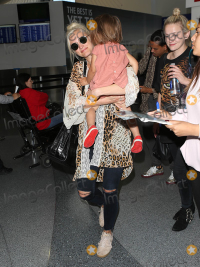 Ashley Simpson Photo - Photo by SMXRFstarmaxinccomSTAR MAX2017ALL RIGHTS RESERVEDTelephoneFax (212) 995-11967717Ashley Simpson and her daughter Jagger Snow Ross are seen at LAX Airport in Los Angeles CA