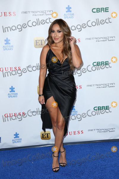 Adrienne Bailon Photo - Photo by JMAstarmaxinccomSTAR MAXCopyright 2016ALL RIGHTS RESERVEDTelephoneFax (212) 995-119692916Adrienne Bailon at the 2016 Metropolitan Fashion Week signature event - La Vie En Bleu - benefiting Autism Speaks(Burbank CA)