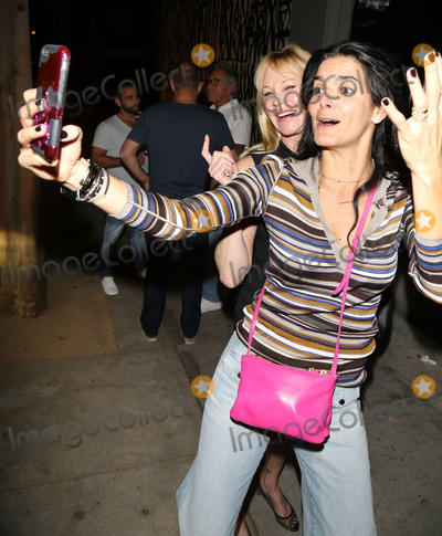 Melanie Griffith Photo - Photo by gotpapstarmaxinccomSTAR MAXCopyright 2017ALL RIGHTS RESERVEDTelephoneFax (212) 995-1196102717Melanie Griffith and Angie Harmon are seen in Los Angeles CA