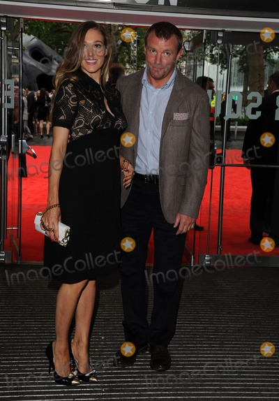 GUY RICHIE Photo - Photo by KGC-42starmaxinccom2012STAR MAXALL RIGHTS RESERVEDTelephoneFax (212) 995-119671812Guy Richie and Jacqui Ainsley at the premiere of The Dark Knight Rises(London England)US syndication only