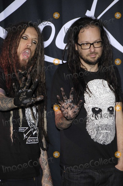 Jonathan Davis Photo - Brian Welch and Jonathan Davis during the induction ceremony to install KORN into the Guitar Centers ROCKWALK on October 8 2013 in Los AngelesPhoto Michael Germana Star Max