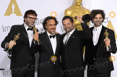 Alexander Dinelaris Photo - Photo by PDstarmaxinccomSTAR MAX2015ALL RIGHTS RESERVEDTelephoneFax (212) 995-119622215Screenwriters Nicolas Giacobone Alejandro G Inarritu Alexander Dinelaris and Armando Bo in the Press Room at the 2015 Oscars held at the Kodak Theatre Hollywood(Los Angeles USA)
