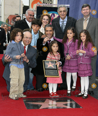 Alejandro Fernandez Photo - Photo by NPXstarmaxinccom200512205Alejandro Fernandez (with Vincent Fernandez Placido Domingo and his kids) receives his star on the Hollywood Walk of Fame(Los Angeles CA)
