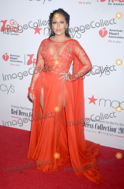 Adrienne Bailon Photo - Photo by Dennis Van TinestarmaxinccomSTAR MAXCopyright 2018ALL RIGHTS RESERVEDTelephoneFax (212) 995-11962818Adrienne Bailon Houghton at the American Heart Associations (AHA) 2018 Go Red For Women Red Dress Collection Fashion Show in New York City(NYC)