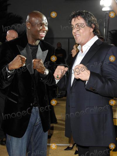 Antonio Tarver Photo - Photo by Michael Germanastarmaxinccom2006121306Antonio Tarver and Sylvester Stallone at the premiere of Rocky Balboa(Hollywood CA)