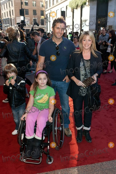Sam Neill Photo - Lucy Alexander (R) and family pose for photographers on the red carpet at the UK premiere of Warner Bros Legend of the Guardians The Owls of GaHoole held at Odeon cinema in Londons West End  The adventure and fantasy animation directed by Zack Snyder (Watchmen 300) features the voices of Helen Mirren Sam Neill Jim Sturgess and Geoffrey Rush  Based on a popular book series the family film has been described as a childrens version of Braveheart with reviews saying its a dark and dense tale filled with noble warriors mighty clashes and feathers flying London UK 101010
